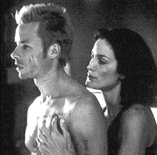 Carrie-Anne Moss and Guy Pearce share a moment.