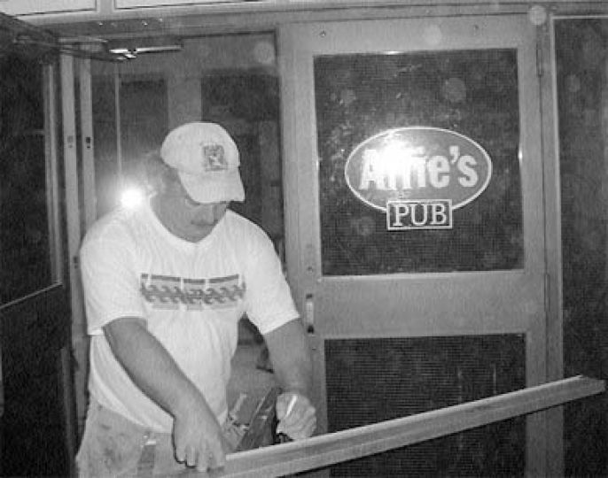 Construction worker Dan Frizzel works to implement the AMS vision for Alfie's. One of the first things to go was the name and logo: Alfie's Pub is just Alfie's now.