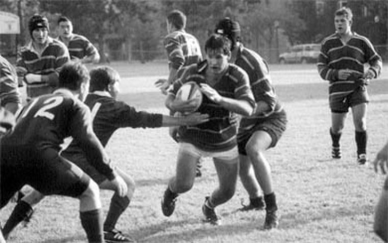 Eight-man Jim Aru eludes two Dartmouth defenders in a second team exhibition match Friday.
