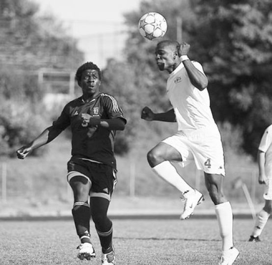 Gaels' striker Stephane Detchou (left) pursues a Toronto defender as the ball is cleared. The Gaels tied Toronto 1-1.