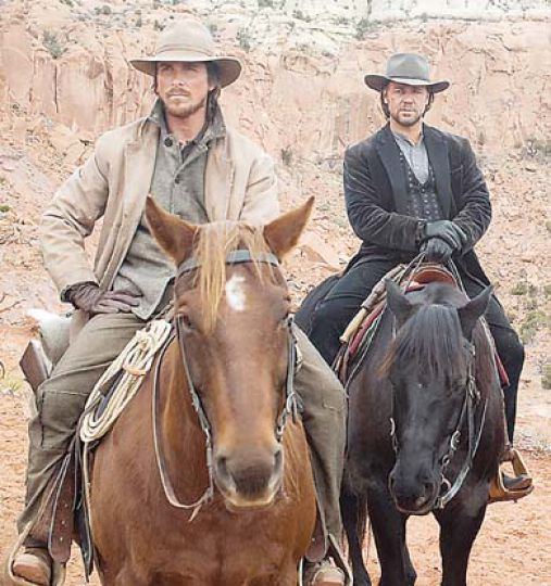 Chrisitan Bale and Russel Crowe provide a complex and interesting foil to one another with their first-class performances in James Mangold's scenic and exciting 3:10 to Yuma.