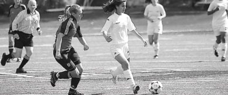 Gael defender Aleisha Marchant (19) chases down the ball in Saturday's game in Toronto.