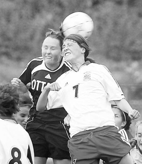 Claire Parsons (7) goes up for a header Wednesday as Katie Dalziel looks on.