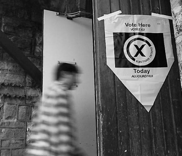 A voter enters Chalmers United Church on Wednesday.