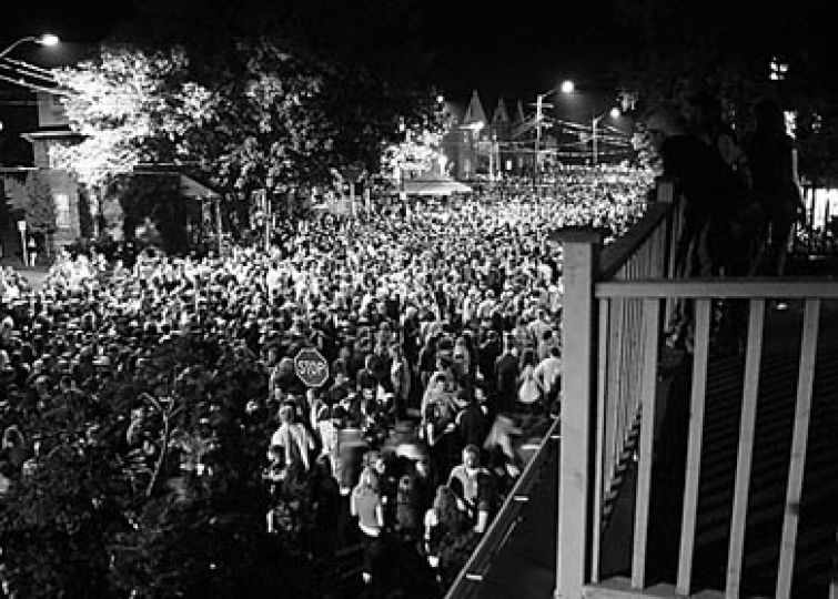 Partygoers gather on Aberdeen Street for Homecoming 2006.