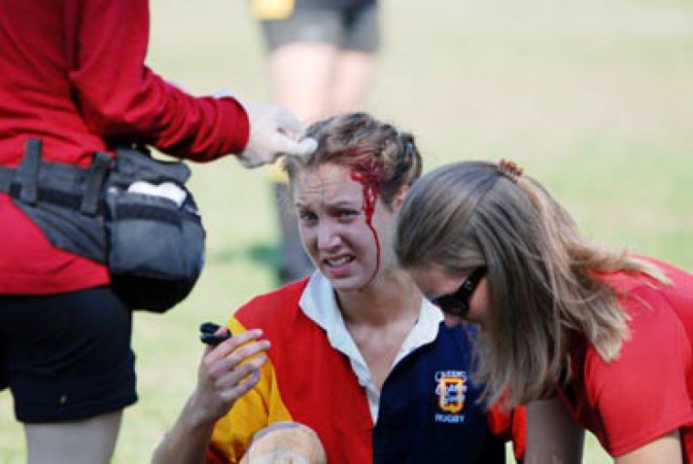 Queen's centre Julie Engelhart gets some repairs during the Gaels' 8-7 loss to Waterloo. She later returned to action.