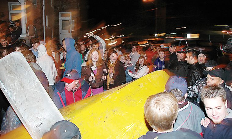 At 11:22 p.m., partiers carried a sailboat from an Aberdeen backyard onto the street. About 20 people climbed on top of it, jumping up and down and singing, 'Olé, olé olé olé.'