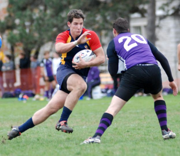 Gaels' rugby captain James Potter eludes a Western defender in Saturday's game. The Gaels beat the Mustangs 16-13.