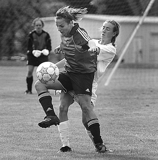 Gaels' striker Laura Vanderlaan traps the ball and prepares to shoot Saturday against Carleton. Queen's won the game 2-0.
