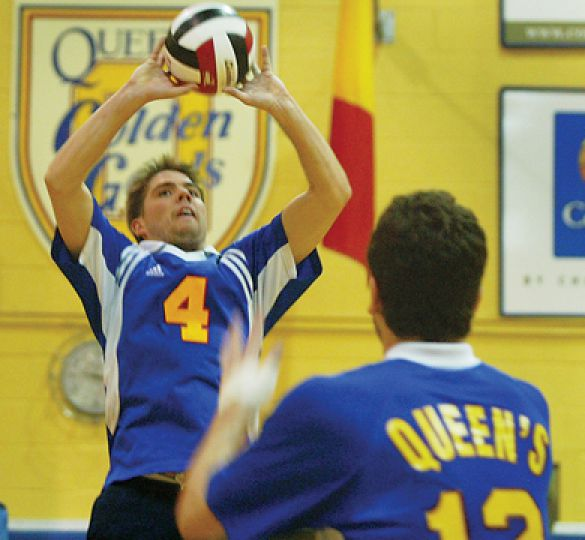 Queen's setter Devon Miller, CIS leader in assists, sets the ball for middle hitter Nick Gralewicz Saturday night against Waterloo.