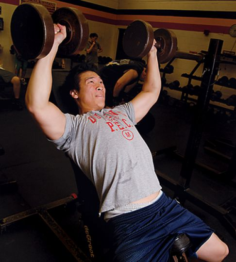 Justin Tsang, Comm '08, pumps iron in the PEC's weight room.