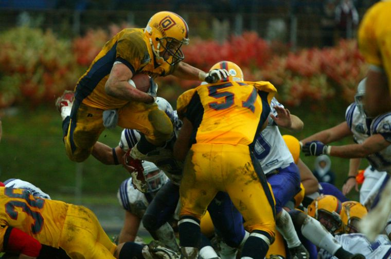 Running back Mike Giffin flies high for the Gaels in their season-ending loss to Western.