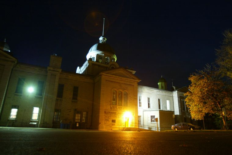 Spirits of hanged prisoners reportedly haunt the Frontenac County Courthouse parking lot, where a jail once stood.