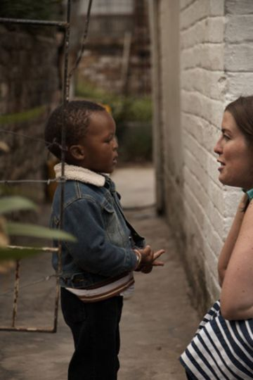 Stephanie Nolen, right, speaks to a child in Alexandra township, Johannesburg.