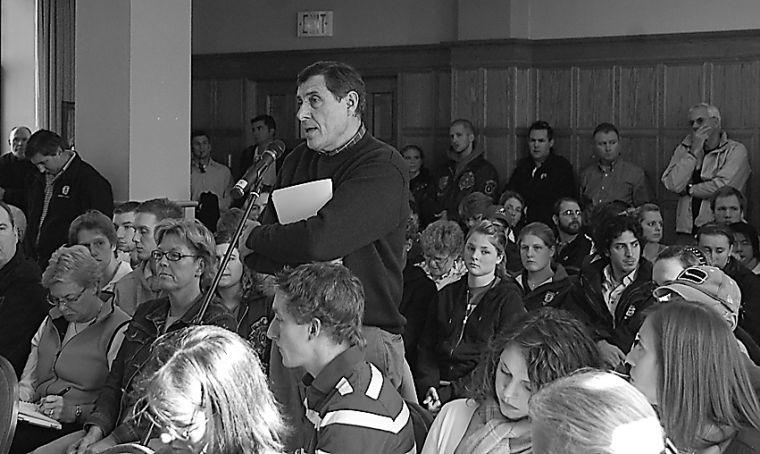 Squash coach Eugene Zaremba states his case at Tuesday's town hall.
