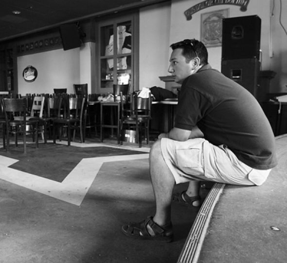 Engineering Society President Charlie Scott sits inside an empty Clark Hall Pub after its June 29, 2007 closure.