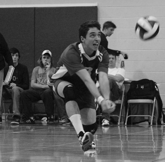 Libero Stu Hamilton makes a dig against Western Friday night. The Gaels won in five sets.