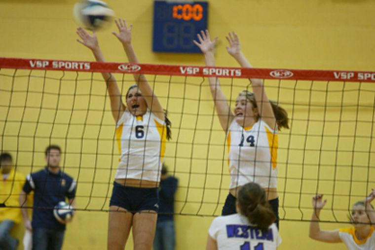 Elyssa Heller (6) attempts a block in a Jan. 11 game against Western as teammate Christiane Taylor looks on. Heller recorded 11 kills for the Gaels in their five-set victory over Ryerson.