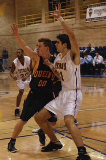 Gaels' forward Jon Ogden (00) tries to get open against Ryerson's Igor Bakovic Friday.