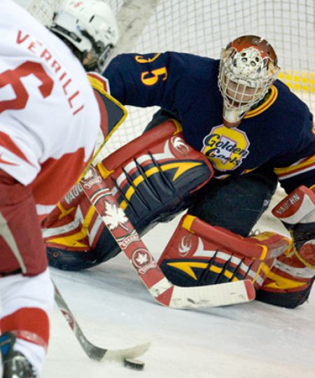 McGill forward Leonard Verrilli breaks in on Queen's goaltender Brady Morrison Friday in Montreal. The Gaels lost 10-1.