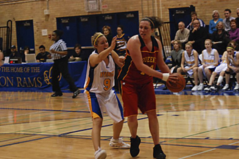 Queen's forward Anne Murphy (14) fends off Ryerson's Rebecca Cox in the Gaels' loss Friday.