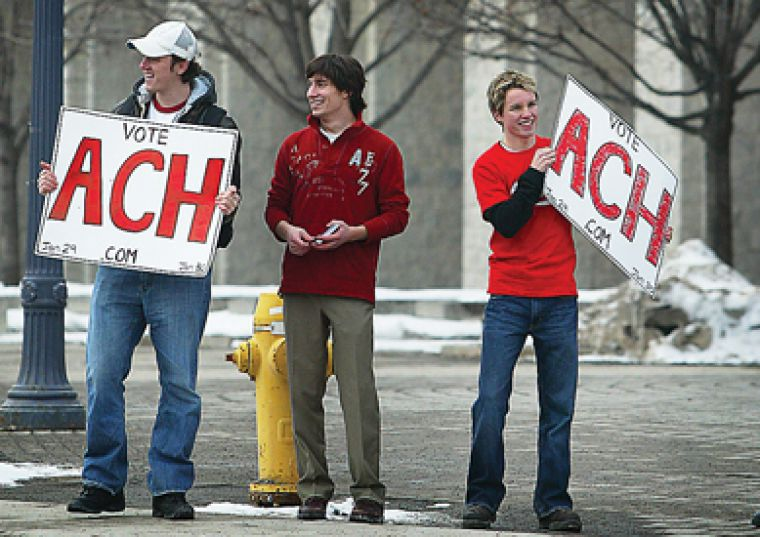 Jeffrey Howard, team ACH vice-president (university affairs) candidate (centre), spreads his message with supporters Jack Bolland (left) and Mitch Piper. Voting begins today.