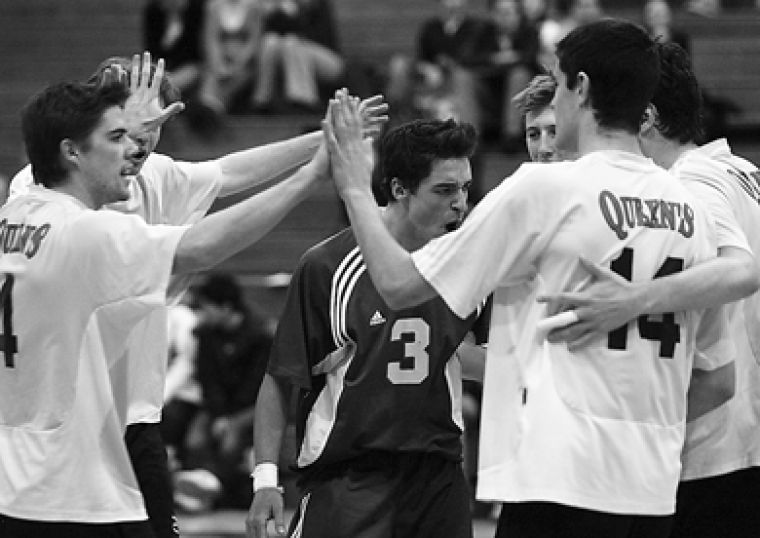 The men's volleyball team celebrates after scoring a point Saturday night against York.