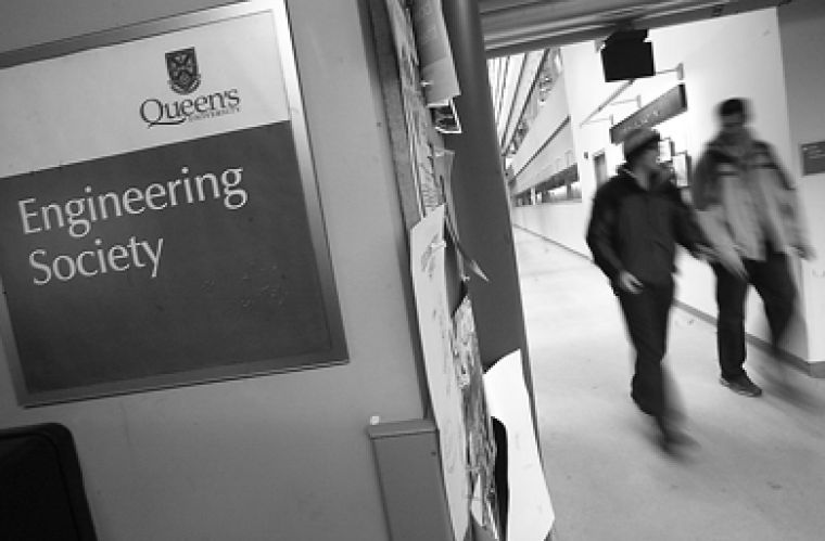 Students walk by the Engineering Society office in the Integrated Learning Centre in Beamish-Munro Hall.