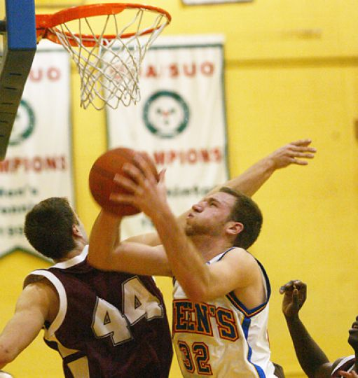 Men's basketball forward Mitch Leger tries for a layup against Ottawa centre Dax Dessureault Tuesday. The Gaels lost 74-70.