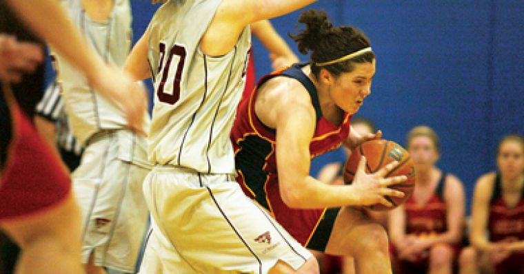 Women's basketball point guard Teddi Firmi drives to the hoop against Ottawa guard Melina Wishart Tuesday night.