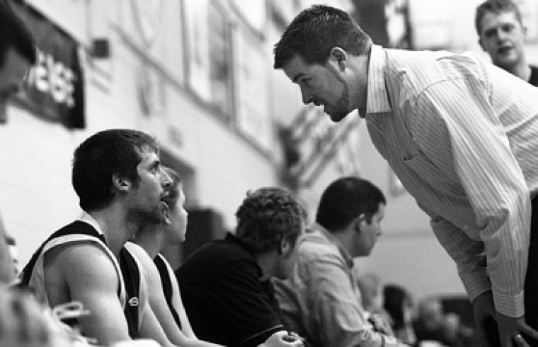 Queen's point guard Baris Ondul gets an earful from assistant coach Duncan Cowan Saturday.
