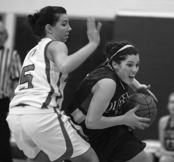 Queen's point guard Teddi Firmi drives against counterpart Brittany Szockyj of the OUA East-leading York Lions Saturday night.