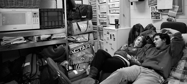 Queen's First Aid volunteers Elizabeth Purssell, ArtSci '10, and Justin Everett, Sci '08, relax after responding to a call on a Friday night shift.