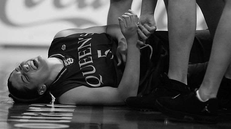 Gaels' point guard Teddi Firmi grimaces in pain during Queen's 68-66 win Friday over Ottawa.