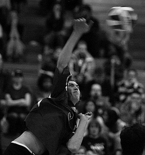 Sam Pedlow of the men's volleyball team goes for a kill Saturday night. The team was ranked first in the review.