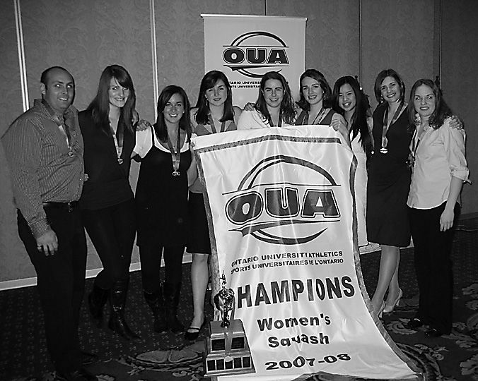 The women's squash team pose with their OUA banner.