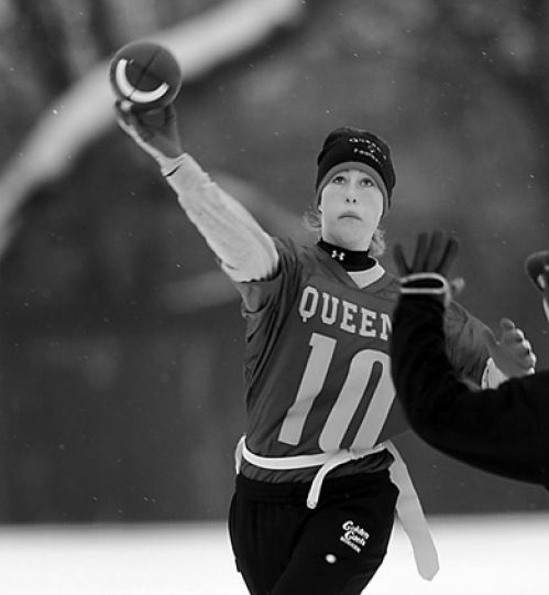 Queen's Powderpuff football team quarterback and running back Laura Johnstone throws a pass last weekend.