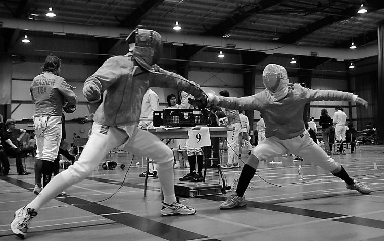 Greg Nonato (right), who came third in men's sabre at the OUAs, competes Nov. 3 at RMC.