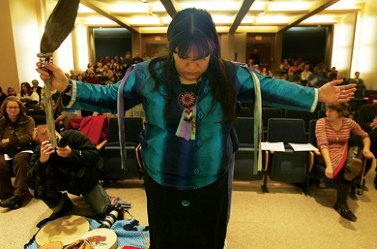 Lorie Young of the Three Sisters Company prepares for the forum on uranium mining held on March 7 in Ellis Hall.