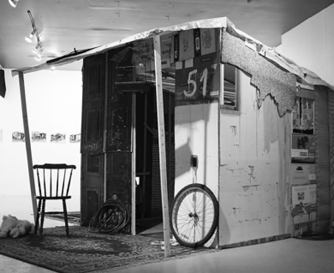 Parallel World features a reconstructed shanty sculpture comprised of old bicycle wheels and stuffed animals that tries to present an alternate idea of home.