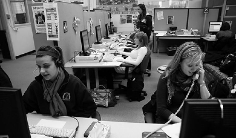 Queen's telefundraisers Tiffany Eaton, ConEd '09, and Dorothy Wajnblum, MIR '08, call alumni to ask for donations. As of March 4, Queen's Telefundraising Services had raised $542,278.90 by calling alumni and first-year students' parents.