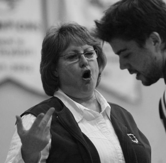 Brenda Willis, seen here with setter Devon Miller in a Feb. 9 game, said management and leadership skills are equally essential in being an effective head coach.