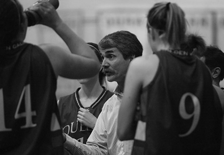 Women's basketball head coach Dave Wilson, seen here in a Feb. 2 game against the York Lions, started coaching while he was playing for the Queen's men's basketball team.