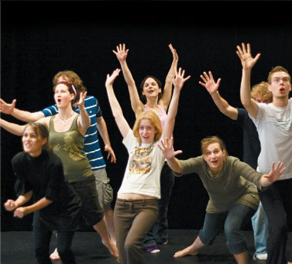 A troupe of Queen's students, let by Kim Renders, comes on between each community group, acting as the chorus that links the production together.