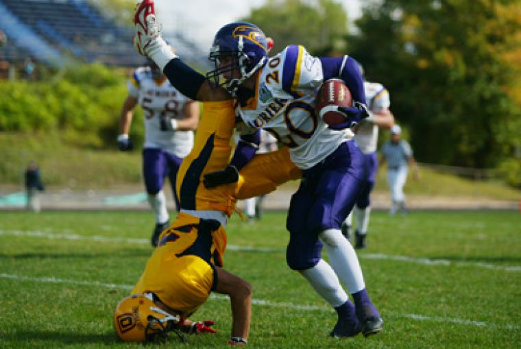 Queen's defensive back Addison Rich gets turned on his head in last year's match-up against Laurier on September 29, 2007. The Gaels lost 23-4. They face Laurier again this Saturday at 1 p.m. at Richardson Stadium.