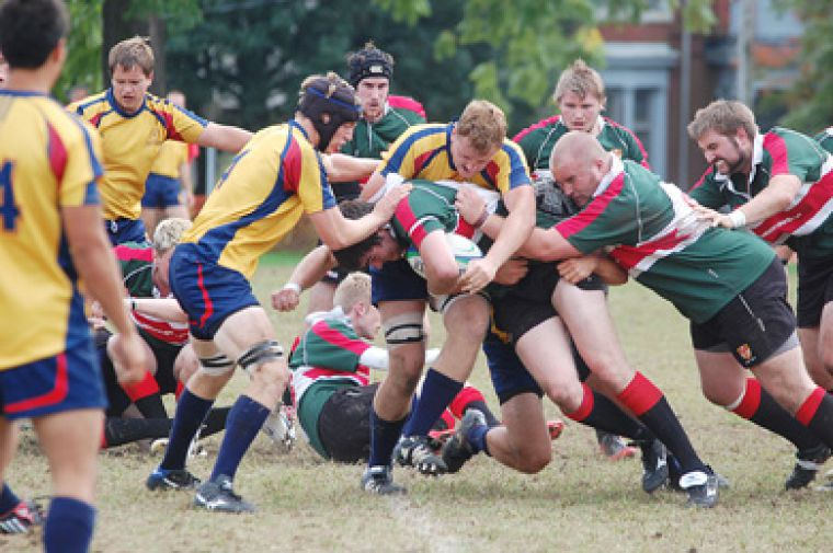 Gaels' locks Tom Binczyk (centre) and Shane Baddeley (left) take down an Ulster player Saturday at Kingston Field.