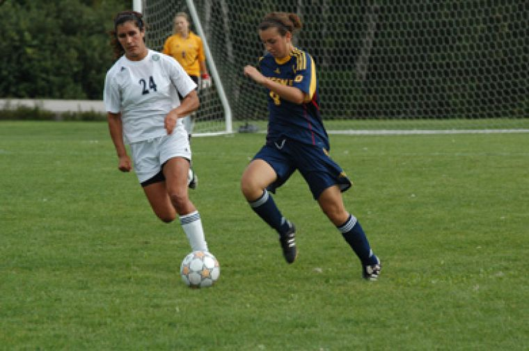 Gaels' defender Katie Dalziel avoids a challenge from Nipissing's Didiane Chollet Saturday.