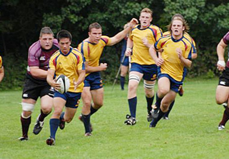Wing Mike Wong evades a Marauder as flanker Alistair Clark looks on.