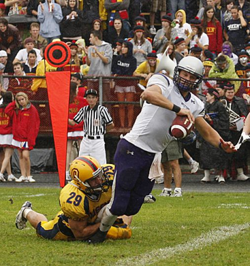 Queen's linebacker Chris Smith sacks Western's quarterback Michael Faulds Saturday.