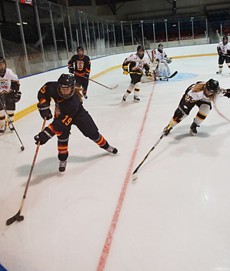Queen's defender Katie Duncan avoids a poke check from Kingston Wolves' defender Heather McLay in Sunday 3-2 Gaels win at the Memorial Centre.